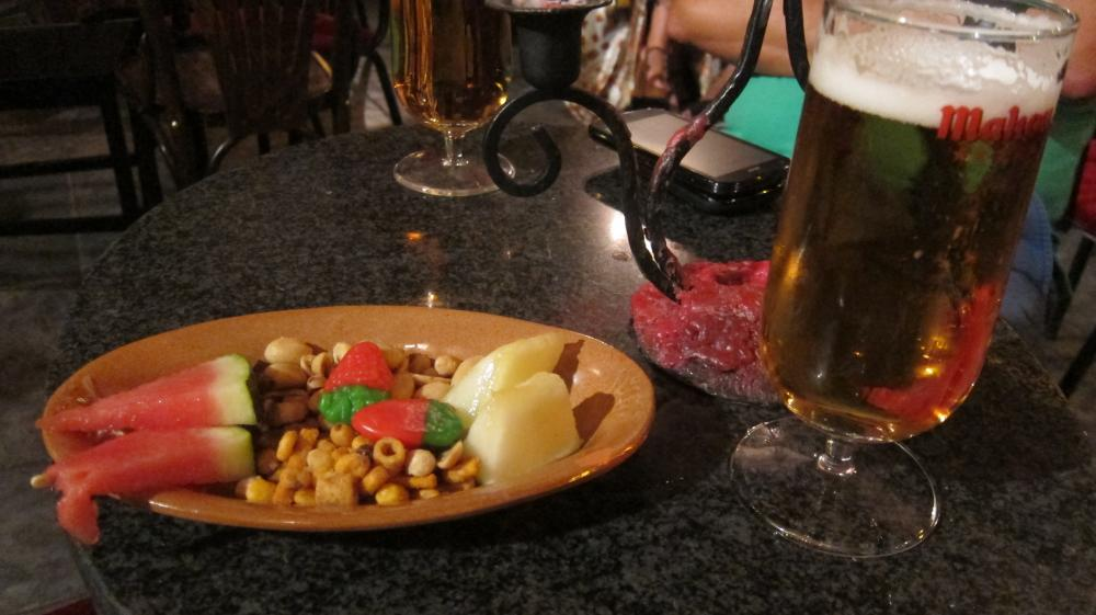 Sweets, fruit and nuts come free with your drink at The bar at Maria Pandora - Champañería Librería, Plaza Gabriel Miró, 1, Madrid, Spain